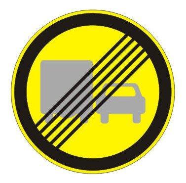 3.23 — Конец зоны запрещения обгона грузовым автомобилям (на желтом фоне)